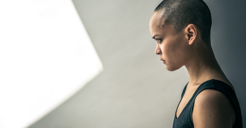 Profile of a person with shaved head