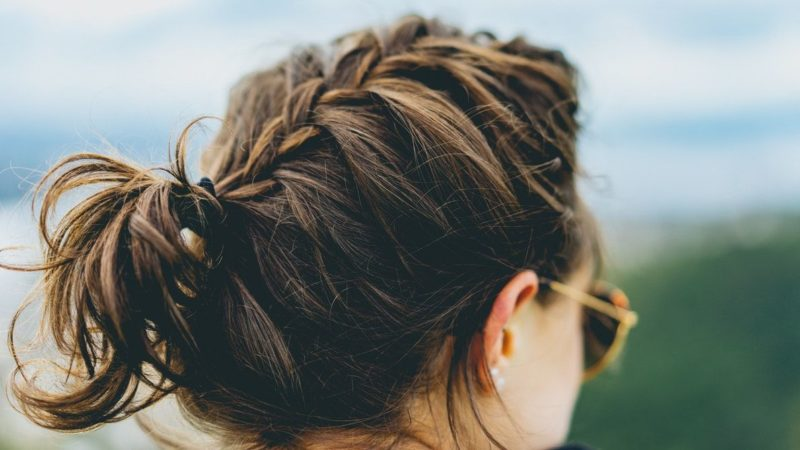 Woman from the back wearing messy braid