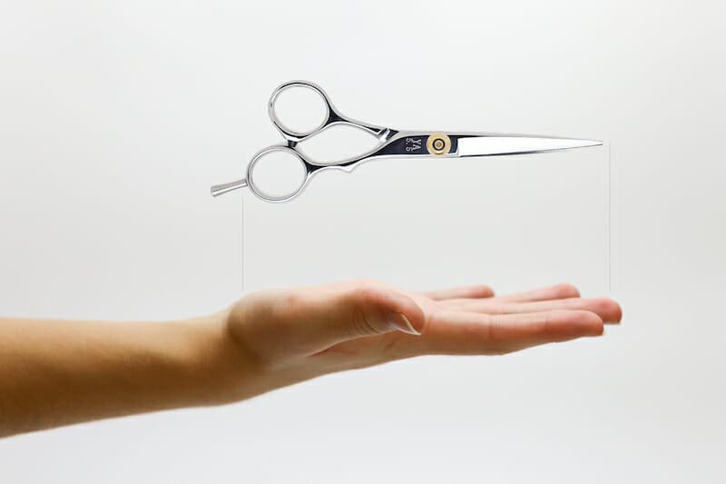 hair cutting scissors length measured against a palm