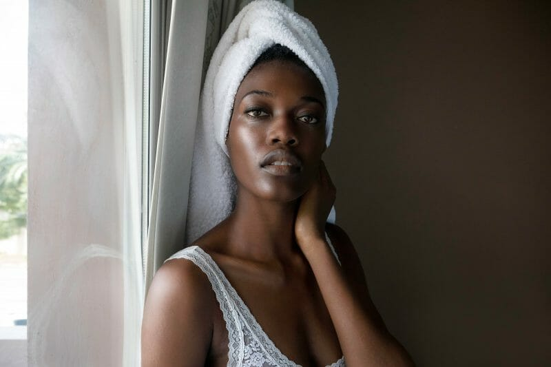 woman with a white towel wrapped around her head