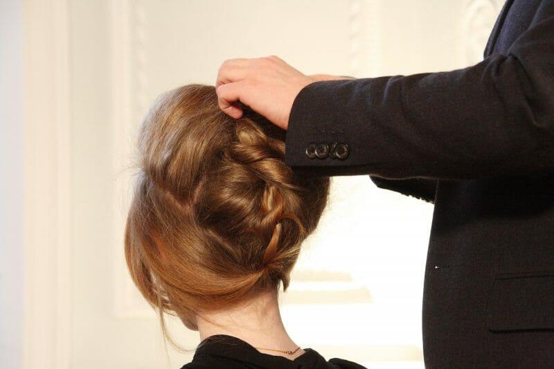 redhead woman getting a hairdo